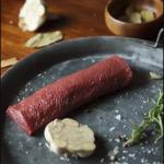 Roast venison backstrap with coffee and prosciutto
